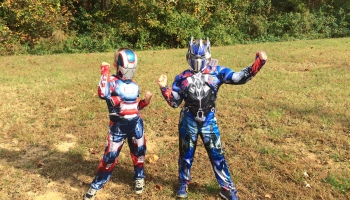 two boys in a field in costumes